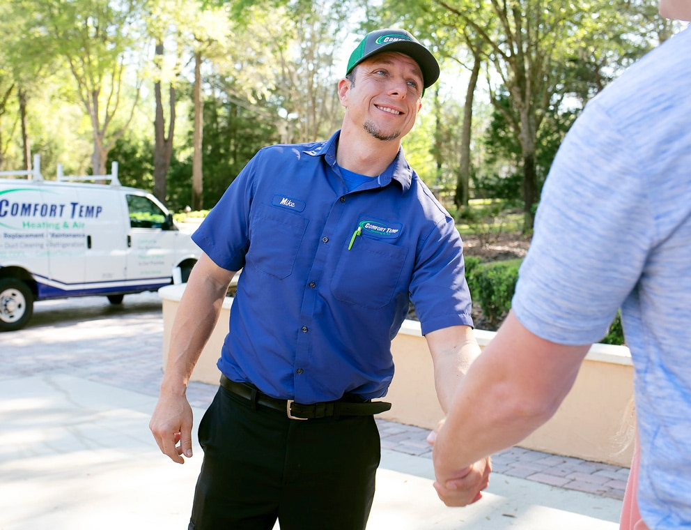 service tech shaking hands with a customer