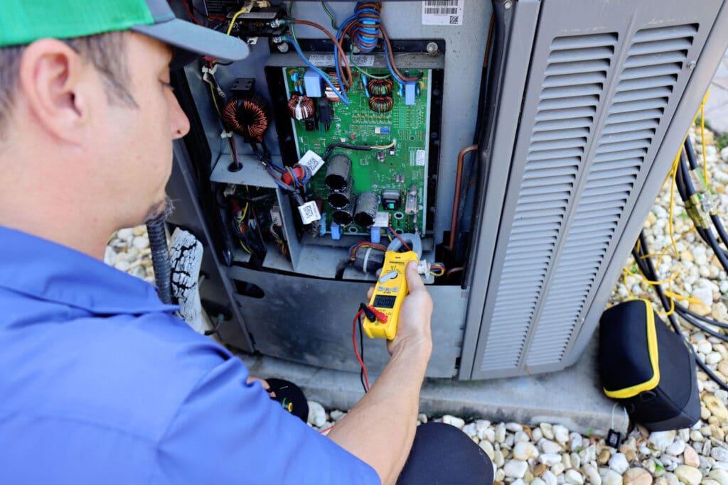 ac technician working on ac unit