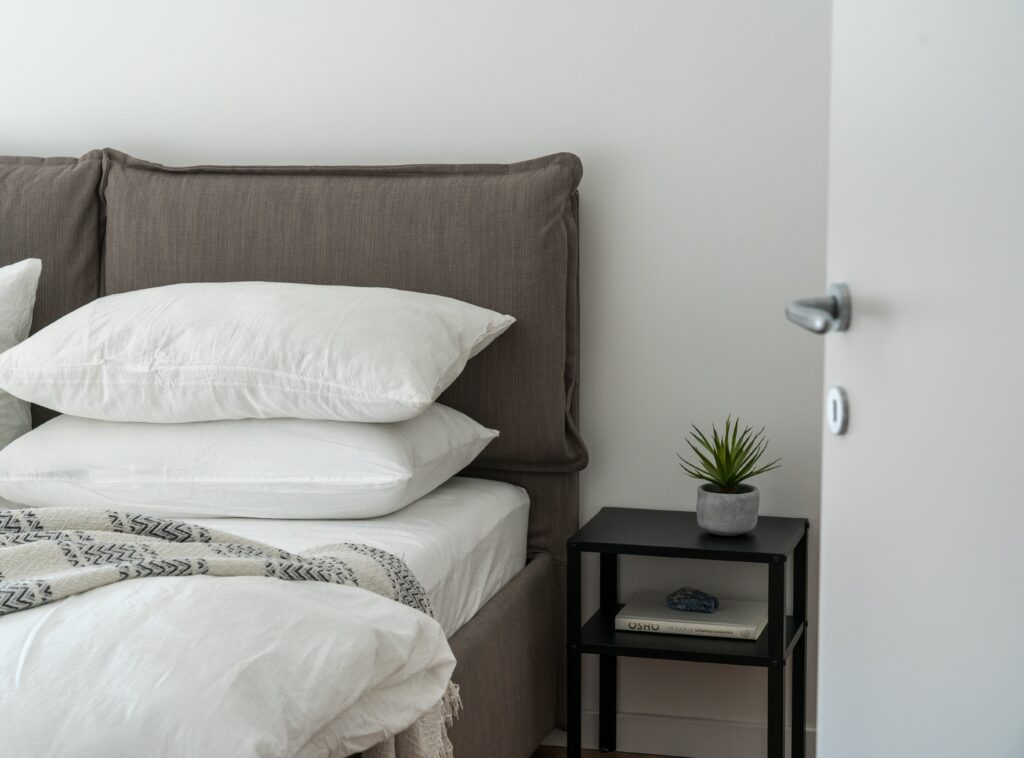 Bed with white pillows